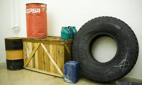 wheel installation, wheel sculpture, wheel contemporary art, laboratory installation, workshop installation, mechanic's art installation, oil installation