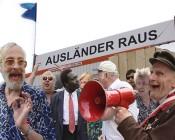 """Christoph Schlingensief, """"Ausländer raus—Bitte liebt Österreich"""", 2000.Photo collage: Paul Poet"""