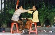 "Mella Jaarsma, ""I Eat You Eat Me,"" 2002. Photographic documentation of a performance in Jakarta, Indonesia."