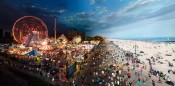 "Stephen Wilkes, ""Coney Island, Day To Night,"" 2011. Digital C-print, 40 x 80 inches.Courtesy Monroe Gallery of Photography."