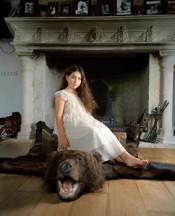 "Anna Skladmann, ""Sonia sitting on the Bear Rug,"" 2009. From the series ""Little Adults."""