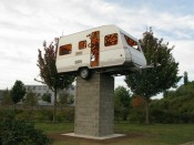 "Claude Lévêque, ""Ring of Fire,"" 2011. Caravan, star wood, lamps, cinderblock base. Caravan: 225 x 565 x 210 cm; base: 298 x 150 x 130 cm.*"