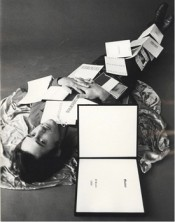 "Jerry McMillan, ""Ed covered with twelve of his books,"" 1970. Gelatin silver print, 13 1/2 x 9 inches (34.3 x 22.9 cm), Edition of 20. Courtesy of Craig Krull Gallery, Santa Monica, California."