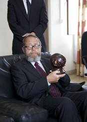 Chief Judge Lars Karlsson holding a commemorative statue of the Bazaramba trial, 2007–2011. Courtesy Thomas Elfgren.