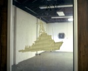 "Lisa Kereszi, Ship on Door of VA Library from the series ""Governors Island, NY,"" 2003. Chromogenic print, framed 20 x 24 inches. Courtesy of the artist and Yancey Richardson Gallery, New York."