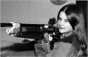 """Peter Piller, from """"Shooting Girls,"""" 2000–05. Courtesy Capitain Petzel, Berlin. © Peter Piller/2014 Pro Litteris, Zurich."""