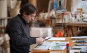 Ignasi Aballí at work in his Barcelona studio, 2014. © Fundació Joan Miró, Barcelona. Photo: Pere Pratdesaba.