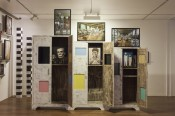 Atul Dodiya, Three Brothers, 2012–13. Three wooden cabinets (treated with polyester putty and zinc powder) glass, enamel paint, framed photographs (archival digital print on Hahnemuehle bamboo paper), cloth, iron hanger and iron crutches; from left to right: 78 x 42 x 18 inches / 72 x 36 x 18 inches / 66 x 36 x 18 inches.