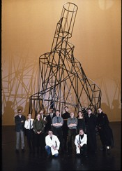 A group portrait of NSK members in front of a model of Tatlin's Tower from the Scipion Nasice Sisters Theatre production Baptism under Triglav, 1986. Photo by Marko Modic.