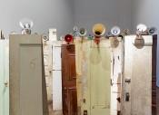 Kader Attia, Asesinos ! Asesinos!, 2014. Installation, 134 doors and 47 megaphones. Courtesy the artist and Lehmann Maupin. Photo: Elisabeth Bernstein.