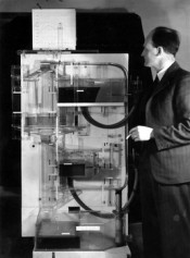 Bill Phillips beside the first prototype of his hydromechanical model, 1949. Courtesy of the Archives of the London School of Economics, London.