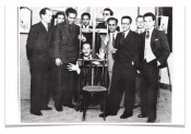 Art and Liberty group members at their second exhibition of independent art, 1941. Gelatin silver print, 12 x 17 cm. Front (from left to right): Jean Moscatelli, Kamel el-Telmissany, Angelo de Riz, Ramses Younan, Fouad Kamel. Back (from left to right): Albert Cossery, Maurice Fahmy, Georges Henein, unidentified, Raoul Curiel. © The Younan Family Archive.
