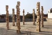Gigi Scaria,Woodhenge, 2016. wood,12 x 1 x 1 feet.Courtesy the artist, New Delhi.